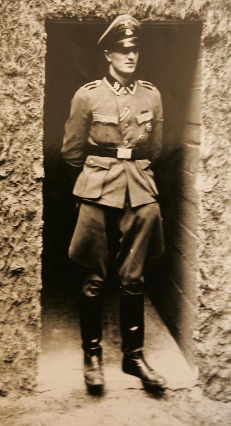 """Rochus Misch, Hitlers body guard, in front of the """"Führerhauptquartier der """"Wolfsschanze"""" in 1944."""