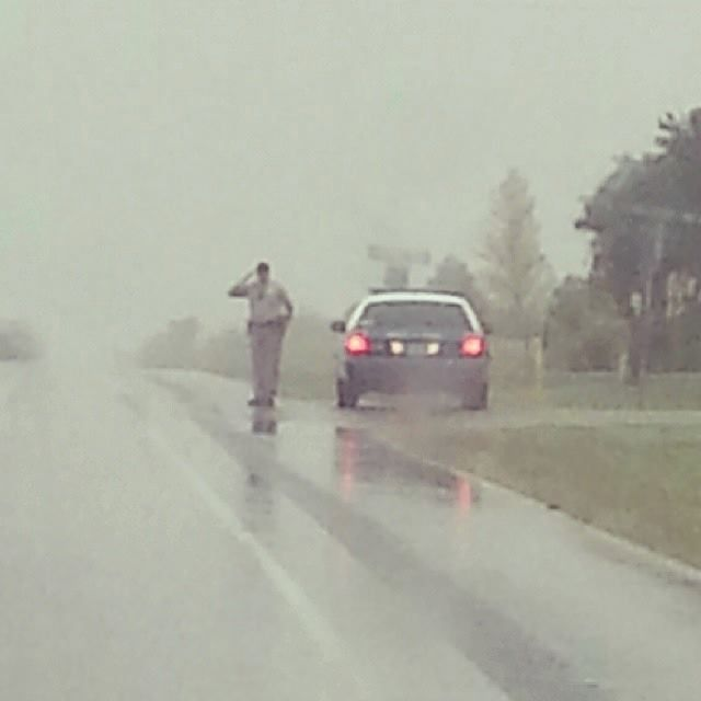 Oklahoma police officer salutes funeral procession in the rain - Imgur