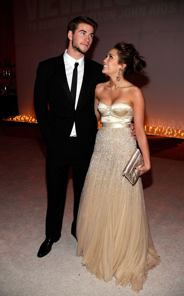 Miley Cyrus and Liam Hemsworth----LAWD the things I would have done to keep that man....WOOOOO.