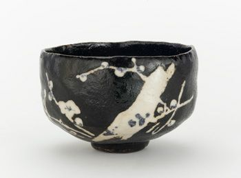 Tea bowl with design of blossoming plum tree, unknown Raku ware   19th century Edo period   Raku-type pottery with Black Raku glaze; white slip and cobalt pigment under clear glaze   Kyoto, Japan