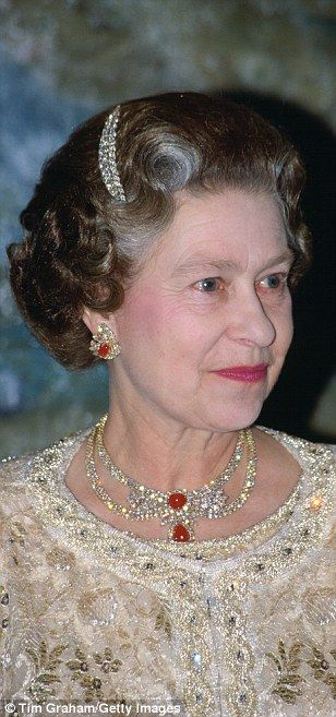Rubies are among the Queen's favourite gems, and these unusual earrings - rubies set insid...