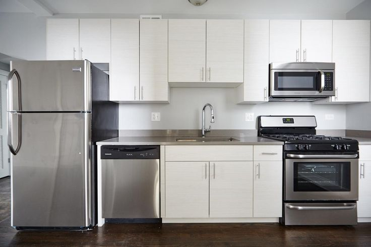 Enjoy clean design at this Logan Square 3-bedroom just one block from the Blue Line. Hardwood floors, stainless appliances, washer/dryer, and great finishes