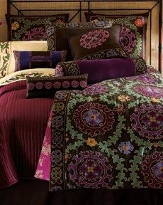 Take a look at http://www.naturalbedcompany.co.uk/indian_quilts.php for embroidered, exotic bedding....