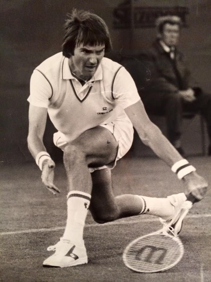 Perfect form:  Jimmy Connors getting down low to handle a low ball.