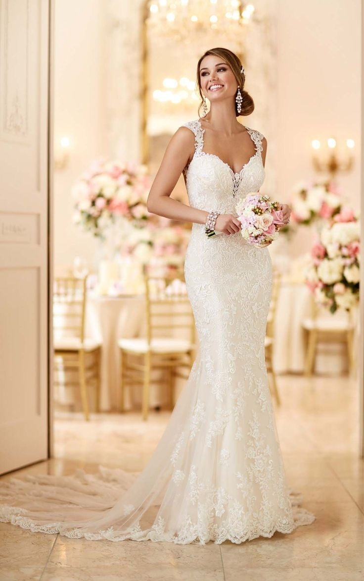 This romantic lace over matte-side Lustre satin wedding gown from Stella York meets all the desires of a modern bride.