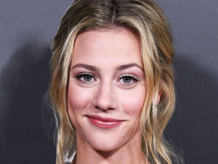 Riverdales Lili Reinhart doesnt have a problem telling it like it is whether that means sharing her beauty routine when shes stuck at home with bronchitis getting real about her misconceptions about sex or most recently calling out a magazine for Photoshopping her body in a social media post.  On Thursday Reinhart called out Cosmopolitan Philippines for altering images of her and co-star Camila Mendes from the February cover shoot of Cosmopolitan US trimming each of their waists to appear…