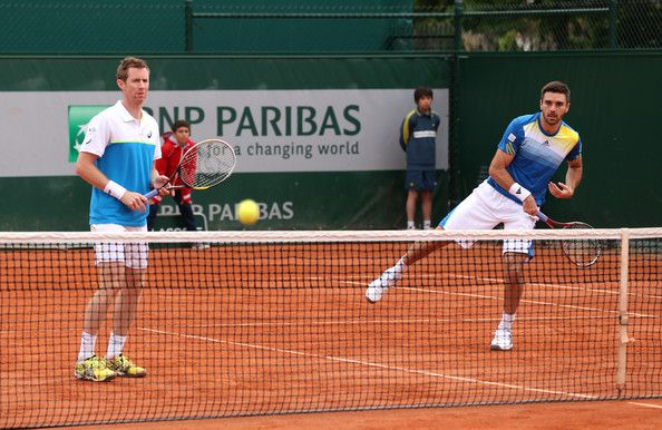 Jonathan Marray (L) and Colin Fleming of Great Britain in action during their mens doubles match against Feliciano Lopex of Spain and Andre Sa of Brazil during day five of the French Open at Roland Garros on May 30, 2013 in Paris, France.