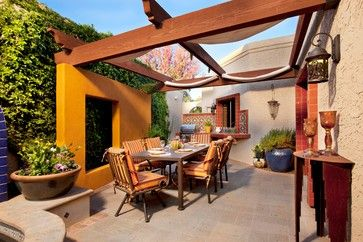 ...Moveable shade fabric patio cover. The fabric is Sunbrella and can be removed to be washed and put away.