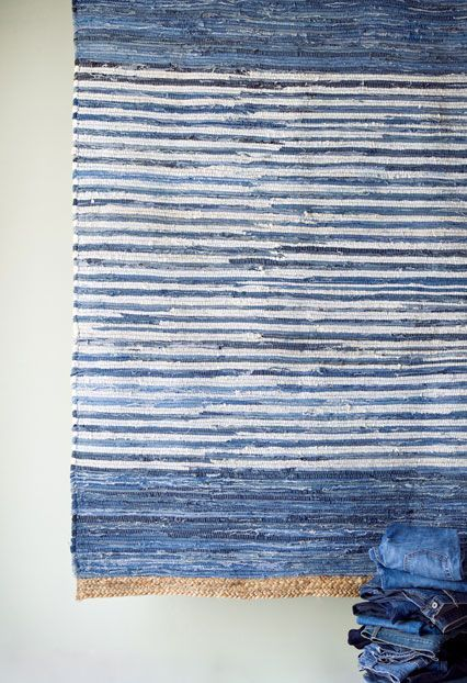 Blue striped rug as wall hanging