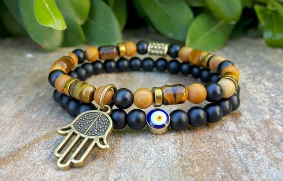 Check out this item in my Etsy shop https://www.etsy.com/listing/236368614/2pcs-hamsa-hand-mens-bracelets-tiger-eye