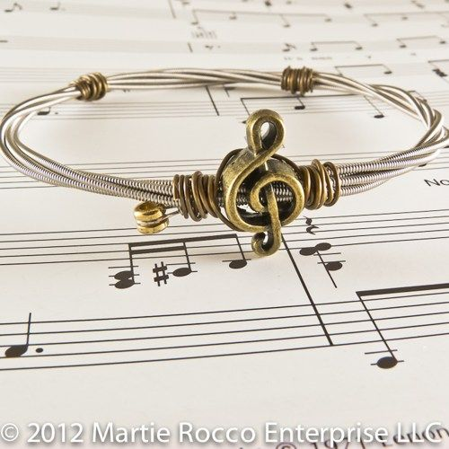 Guitar String bangle antique brass treble charm and wire wrap. GS87