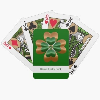 """Lucky Irish Shamrock Clover Playing Cards. Deal a lucky hand with a custom deck of cards featuring a lucky four leaf clover or shamrock. The four leaves of this shamrock, centered on the back of each card, are shiny gold and green. The background color is green (you can change it). The placeholder text says """"Dave's Lucky Deck"""" but you can change this."""
