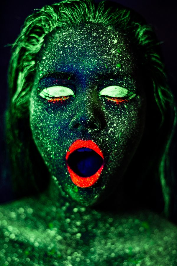 Atlantean woman by Harri Rauhanummi.  By using black lights and same Kryolan UV Aquacolor makeups that Hollywood uses for make up special effects we were able to create this fantasy creature from the sunken city of Atlantis.