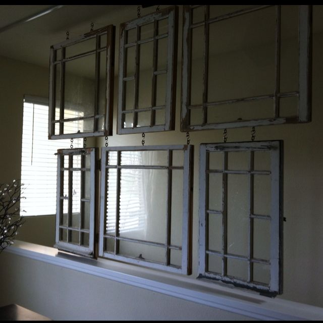 Hangers For Old Window Panes Used As A Room Divider In A Studio