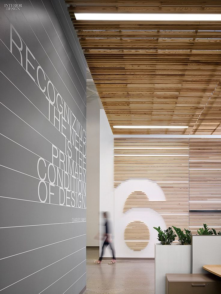 Love the use of timber battens flowing from ceiling to the wall, in particular the number 6 design. Newell Rubbermaid Design Incubator by Eva Maddox.