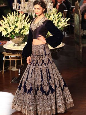 Manish Malhotra's sophisticated black and pale gold traditional lehenga done in ethnic motifs adds grace to Deepika Padukone #ShaadiMagazine