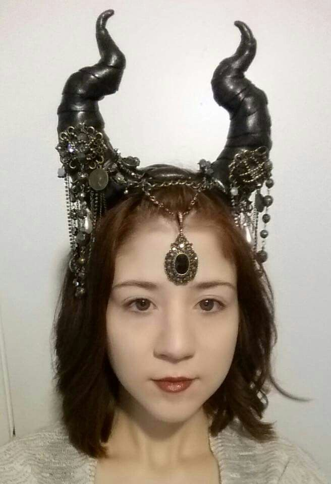 """Bought the head band at spirit of Halloween store for $14. The polymer clay is Super Sculpey. Placed tin foil inside """"horn"""" frame, place clay over frame and shaped into horn. Rolled out clay and """"wrapped"""" it around horn. Baked at 270 for 1 1/2 hours. Spray painted horns black. Placed chains and glued jewelry on with E600 glue"""