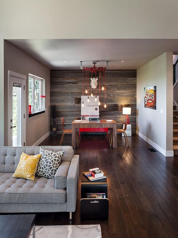 The accent wall in the dining space was reclaimed from a local barn from the 1920's. The wall ties the dining room into the rest of the home where barn wood is used as shelving.: Dining Rooms, Modern Families, Living Rooms, Jordans Iverson, Families Rooms, Modern Home, Wood Wall, Wall Design, Accent Wall