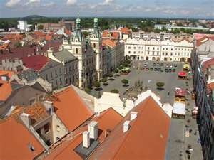 View of the town square from the clock tower in Pardubice, Czech Republic. There is/was a fabulous pizza restraunt in the lower left corner of the square.
