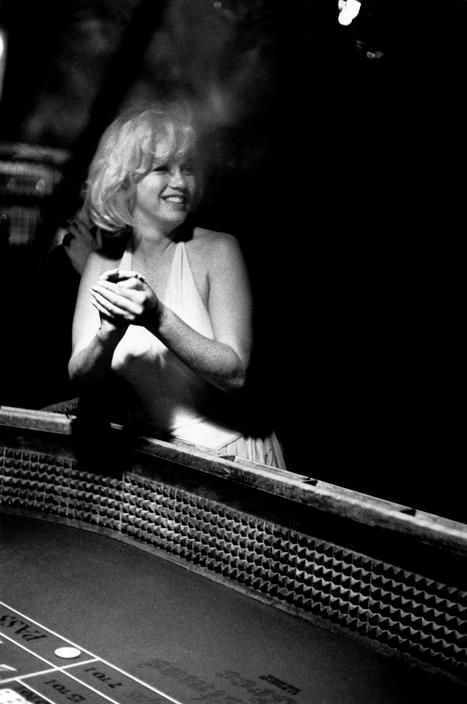 """Marilyn Monroe at a Reno casino during the filming of """" The Misfits"""" 1960. Photo by Eve Arnold."""