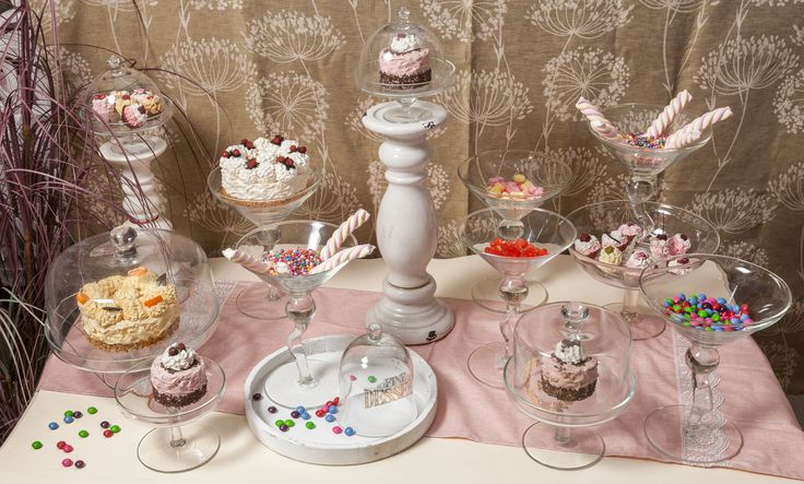 🍰💞🍭A table holding numerous treats for sweet-hearted individuals. Each glass-bell shows the beauty he hides within. One of them has a heart of strawberries, the other assimilates with an orange while the rest of them sprinkle colourful raindrops.💕🍇🍬