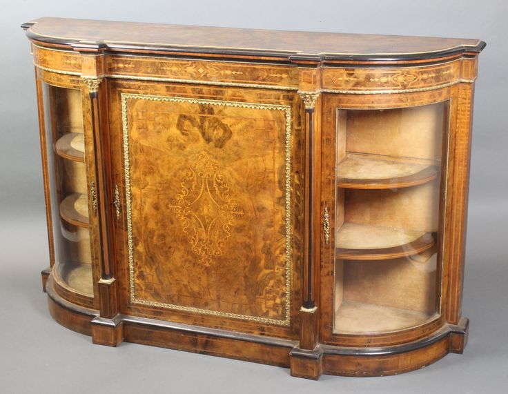 """LOT 900, A mid Victorian inlaid and figured walnut credenza with gilt metal mounts, the centre section enclosed by an inlaid panelled door flanked by bowed doors 39""""h x 61 1/2""""w x 17 1/2""""d SOLD £560"""