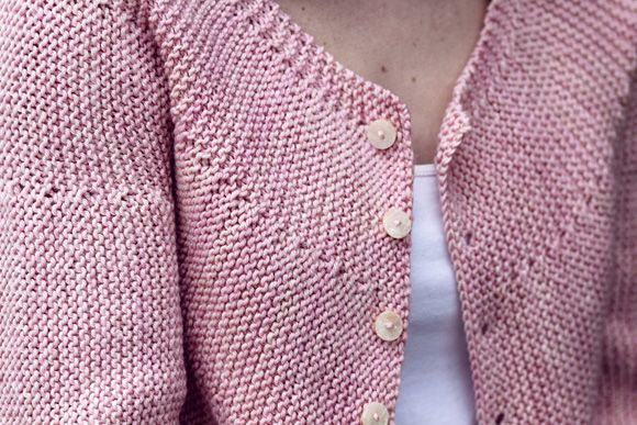 The cardigan is knit all in one piece, from the left side to the right, w/alm...