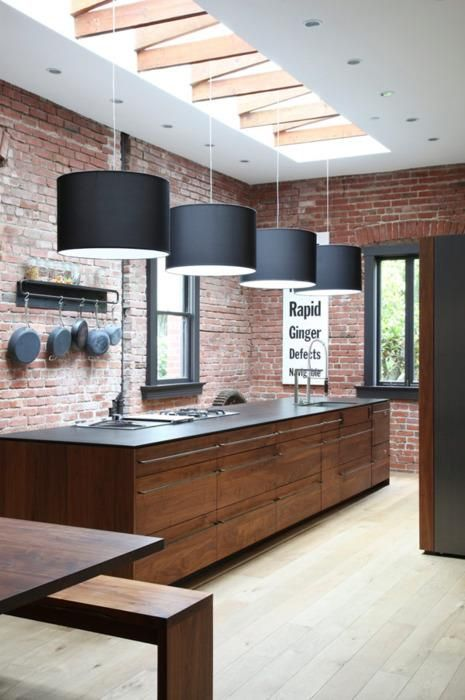 Cool industrial kitchen- brick, rustic wood,  & large pendants.