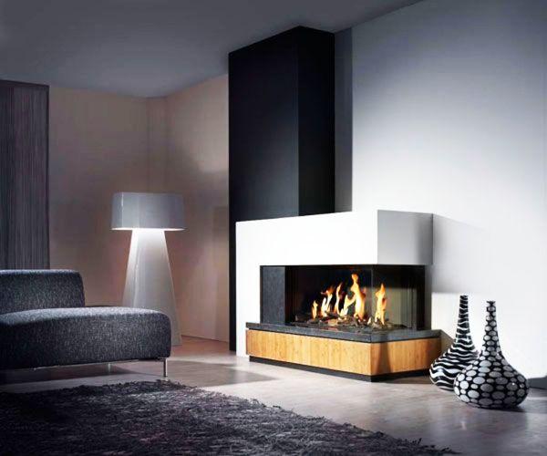 Fantastic contemporary fireplace design for dark living room interior.  #MaisonMatiere #LivingRoom #Home #Decor #Fireplace