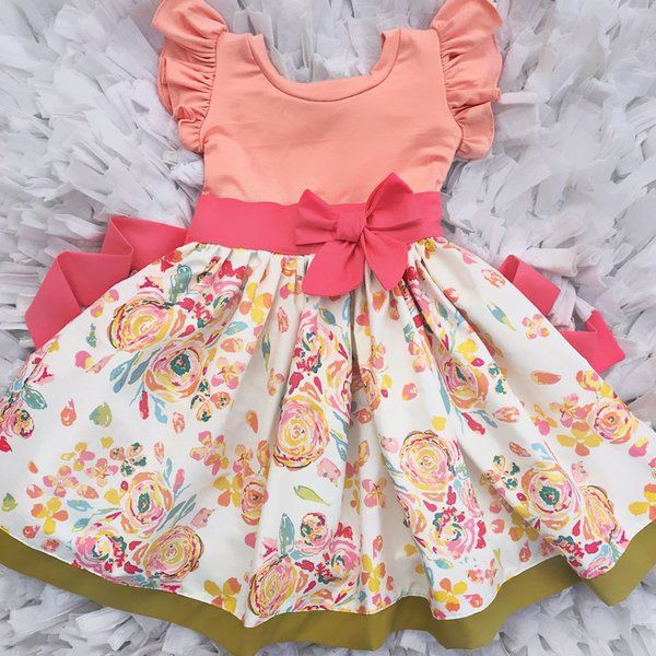 Adorable boutique dress, perfect for Spring, Mother's Day, Summer, photoshoots, birthdays and more! Peach, pink, and green. Girly twirl dress with flutter sleeves
