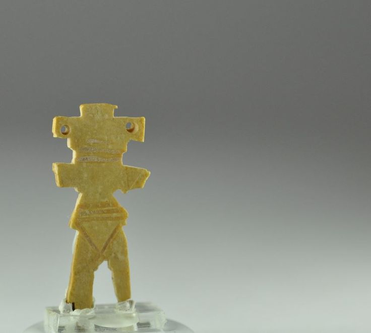 Coptic bone toy doll or pendant, 6th-8th century A.D. Coptic bone miniature toy doll or pendant, two little holed eyes maybe for use as pendant, 3.3 cm high. Private collection