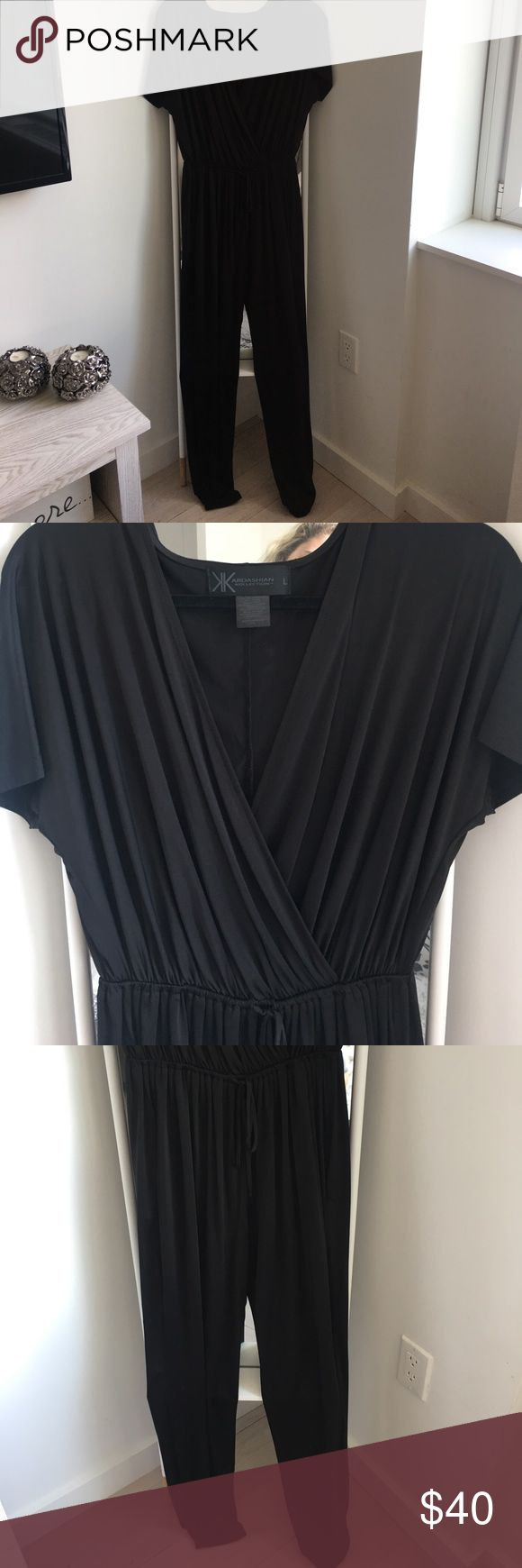 Kardashian Kollection Jumpsuit Kardashian Kollection black jumpsuit. So stylish and in with the jumpsuit trend! Only worn ONCE! Kardashian Kollection Other