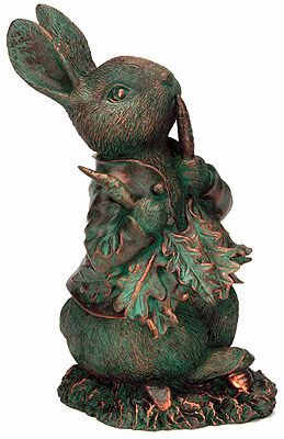 Peter Rabbit with a Raddish  --  This statue is based on the character from the famous British author and illustrator, has become a favourite. Use it indoors or in the garden, made of durable resin with a bronze like patina. Packed with charm, it will enchant your garden.