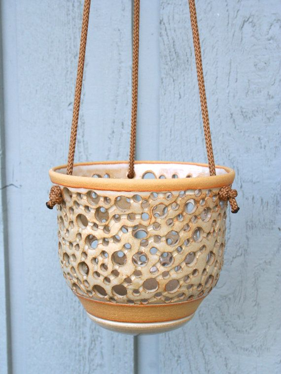 Hanging Stoneware Orchid Pot- this one is $65 but she has a ton of other awesome pots and other ceramic goodies too