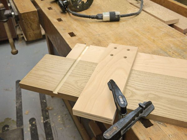 Learn how to build and use a simple router jig for cutting perfectly square shelf dadoes.