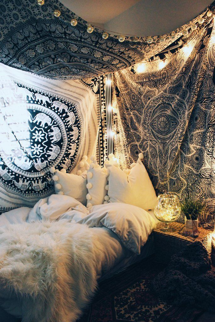 Small bedroom decorating ideas including cozy decor such as faux fur, lots of pillows, blankets, hanging plants, canopies, tapestries, and hanging lights.