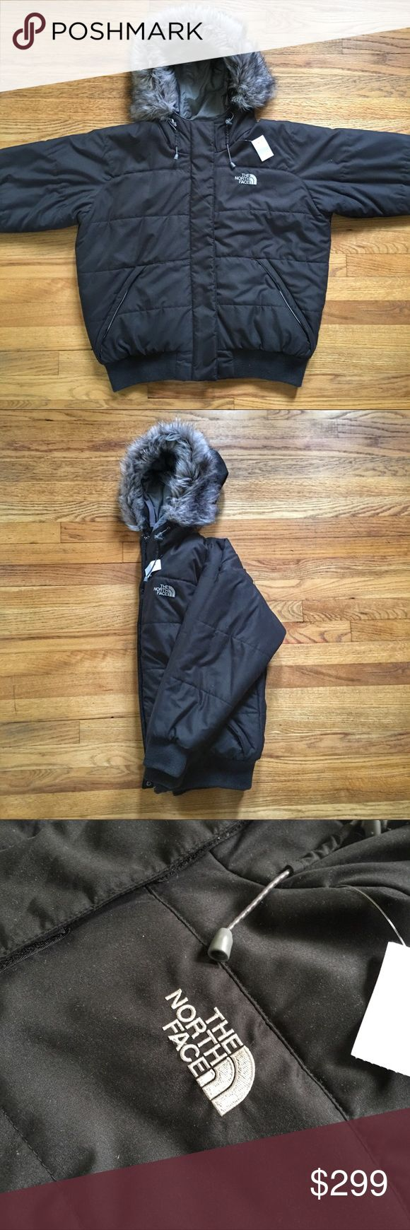 North Face Heavy Insulated Hooded Bomber Jacket North Face Heavy Insulated Hooded Bomber Jacket.  Pre-owned in excellent condition.  Size large.  Color is black.  Faux fur hood.  Retails $299 North Face Jackets & Coats