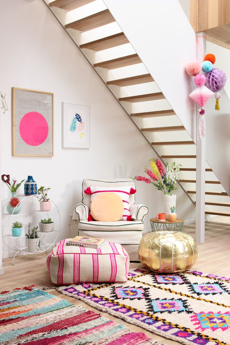 Rug layering & colorful poufs - Baba Souk