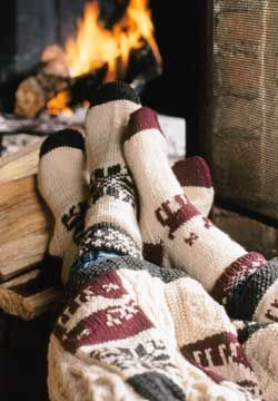 Warm and cozy sock pattern with both a striped version and a rustic fair isle version. sewing, DIY socks, cozy fireplace, rustic clothing, design
