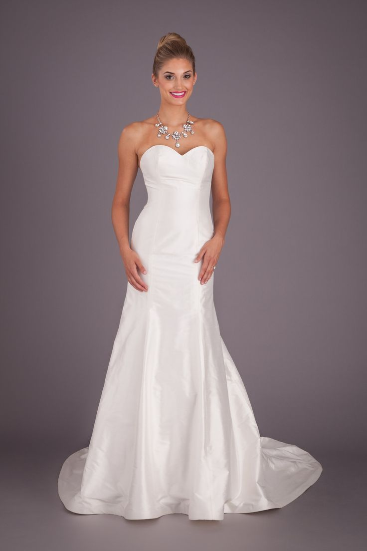 A Timeless And Elegant Fitted Silk Wedding Dress With Strapless Sweetheart Neckline