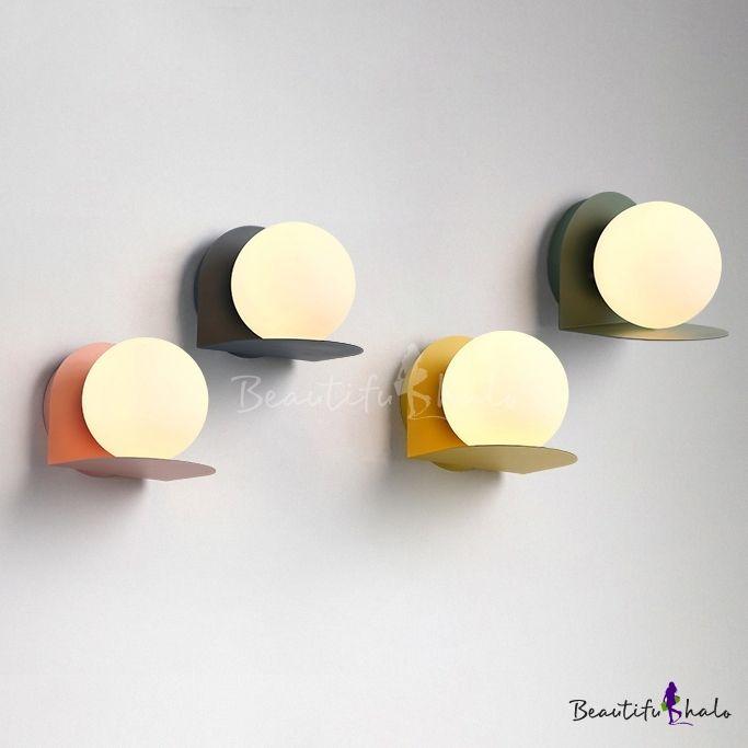 milky glass orb wall light sconce