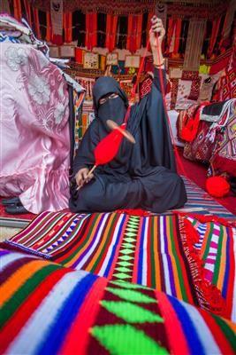 Wool spinning, bedouin woman handicrafts in Saudi Arabia