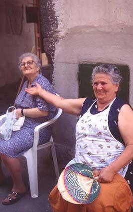 Italian women...probably Nonna's...my Nonna always wore an apron!