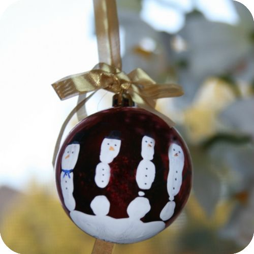 DIY Kids Ornament - allow child to put hand print on ornament, allow to dry. Then decorate fingers as snowmen!