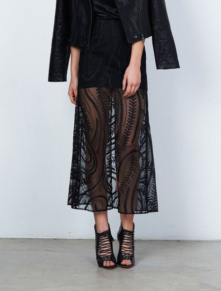 ISLA IMPACT SKIRT from the Stardust Collection. It's a chic game of hide and seek. This black embroidered maxi skirt is cut to sit at the waist and falls in a gentle A-line shape. Sheer from the mid-thigh down, with a deep front split, it's an edgy floor-sweeping piece that hints at what lies beneath. Partially lined, with a concealed rear zip. Available: www.islalabel.com #islalabel #fashion #style #winter #skirt #maxiskirt #sheer #black #chic