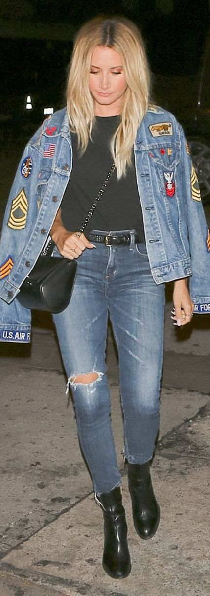 Who made  Ashley Tisdale's black handbag, blue skinny ripped jeans, and jacket?