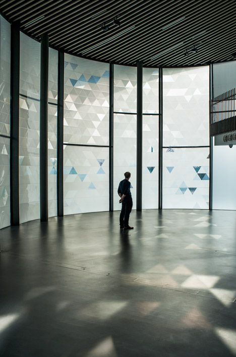 The effect of Simon Heijdens' Shade installation is created using sheets of responsive film fixed to glass panels – a technique the London-based designer debuted at the Art Institute Chicago in 2010.