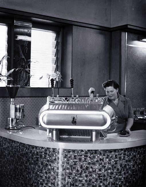 Woman serving expresso coffee at Fails Cafe, 82 Cashel Street, near the Bridge of Remembrance 1955