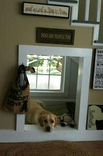 Dogs are people, too, which is why your dog should probably get his or her own little haven underneath the stairs