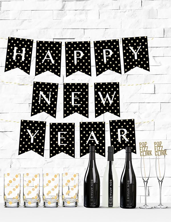 Free Printable Gold Glitter Polka Dot Happy New Year Banner from @chicfetti #freeprintable #nye